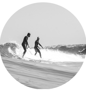 two life long friends surf together